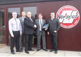 Colin Torley, from Veka presenting Norscot with a decanter and glasses to celebrate 25 years of business with Veka.