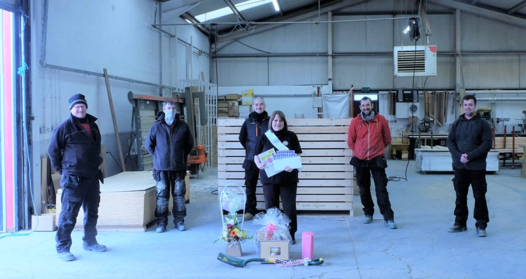 Ellen with her gifts from our workshop operatives